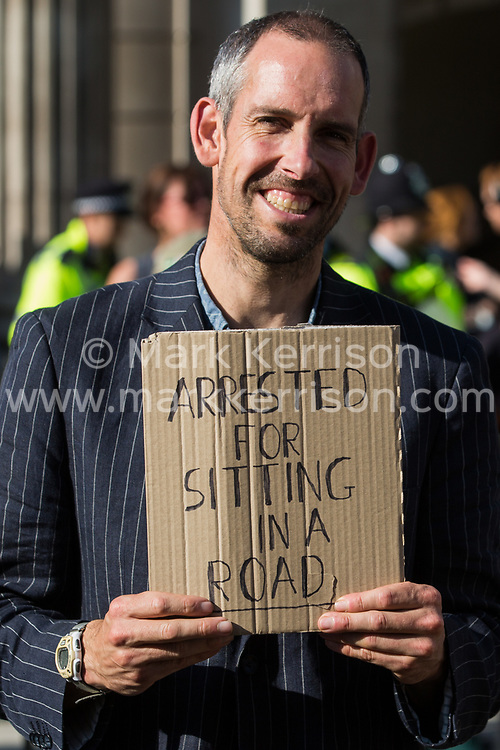 An Extinction Rebellion climate activist protests in front of the Bank of England in the City of London on the eleventh day of Impossible Rebellion protests on 2nd September 2021 in London, United Kingdom. Over 50 activists wore signs indicating that they were breaking restrictive bail conditions by entering the City of London, some of whom dressed for court. Extinction Rebellion are calling on the UK government to cease all new fossil fuel investment with immediate effect.