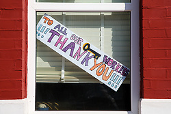© Licensed to London News Pictures. 15/04/2020. London, UK. 'TO ALL OUR KEY WORKERS - THANK YOU' sign is displayed in a window of a house in north London. Coronavirus lockdown continues to slow the spread of COVID-19 and reduce pressure on the NHS.  Photo credit: Dinendra Haria/LNP
