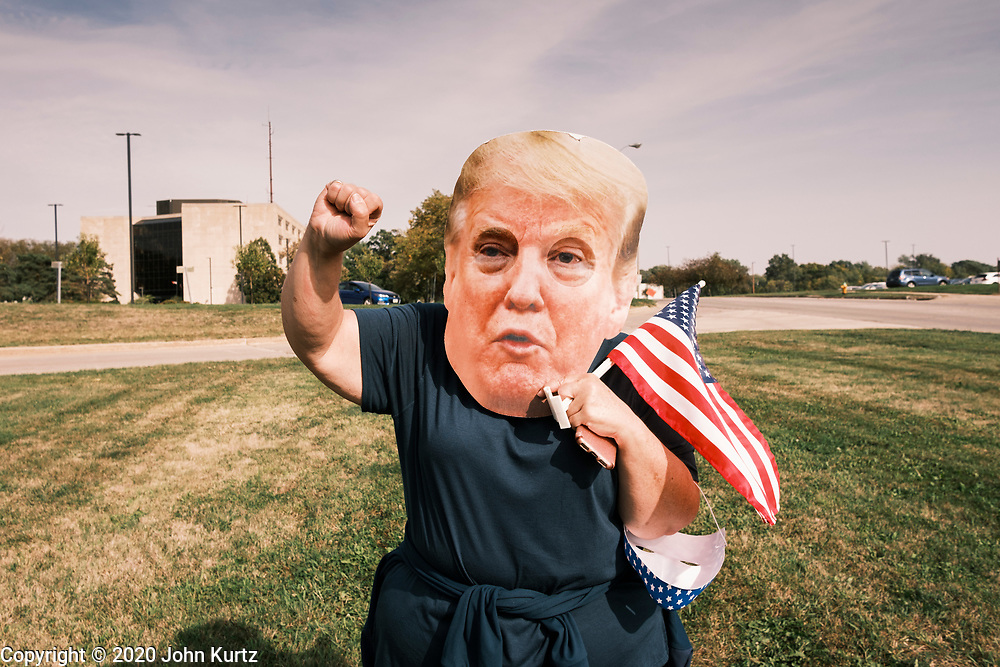 26 SEPTEMBER 2020 - DES MOINES, IOWA: A person wearing a large President Donald J. Trump mask wave to people in a motorcade supporting the reelection of President Trump. More than 1,500 people in 500 vehicles participated in motorcade through Des Moines Saturday. They started in the suburbs south of downtown, drove through downtown, and ended at the State Capitol.        PHOTO BY JACK KURTZ