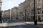 Regent Street, in Londons main shopping and retail area normally full of thousands of shoppers and traffic is virtually deserted due to the Coronavirus outbreak on 23rd March 2020 in London, England, United Kingdom. Following government advice most shoppers are staying at home leaving the streets quiet, empty and eerie. Coronavirus or Covid-19 is a new respiratory illness that has not previously been seen in humans. While much or Europe has been placed into lockdown, the UK government has announced more stringent rules as part of their long term strategy, and in particular social distancing.