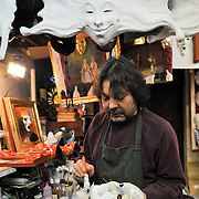 An Artisan at Mascareri paints  a mask in his shop. Artisans, masks and costumes makers are getting ready ahead of Venice Carnival 2013