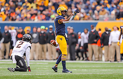 Nov 23, 2019; Morgantown, WV, USA; West Virginia Mountaineers wide receiver T.J. Simmons (1) celebrates a first down during the third quarter against the Oklahoma State Cowboys at Mountaineer Field at Milan Puskar Stadium. Mandatory Credit: Ben Queen-USA TODAY Sports