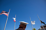 The American flag blows in the breeze above Gunnery Sergeant and former Milpitas Mayor Denny Weisgerber's hat during the Memorial Day Ceremony at Milpitas City Hall's Veterans Plaza in Milpitas, California, on May 26, 2014. (Stan Olszewski/SOSKIphoto)