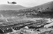 A French helicopter surveys a refugee camp for Kosovar civilians escaping ethnic cleansing by Serb paramilitary and government forces.
