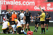 Matteo Minozzi of Zebre Rugby (no15 on ground) is upended in a tackle from Ben John of the Ospreys ©, for which Ben John is yellow carded by referee Quinton Immelman (r) .Guinness Pro14 rugby match, Ospreys v Zebre Rugby at the Liberty Stadium in Swansea, South Wales on Saturday 2nd September 2017. <br /> pic by Andrew Orchard, Andrew Orchard sports photography.