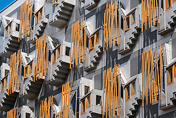 Architectural detail of windows on facade on Scottish Parliament building in Edinburgh Scotland , United Kingdom