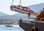 The owner of a wrecked Pacific Airways Dehavilland DHC-2 MK 1 observes the extraction from the water onto the barge Quartz Hill on Thursday, June 27, 2019 at the Westflight docking facility in Ketchikan, Alaska. Bystanders from land and cruise ships witnessed the plane overturning and sinking upon landing in the Tongass Narrows. Everyone onboard survived the event.