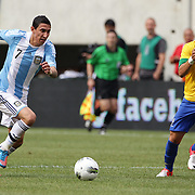 Angel Di Maria, Argentina, (left) is challenged by Giuliano, Brazil, during the Brazil V Argentina International Football Friendly match at MetLife Stadium, East Rutherford, New Jersey, USA. 9th June 2012. Photo Tim Clayton