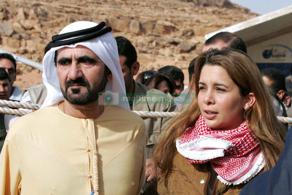 File photo - Jordan's Princess Haya and her husband, Dubai's ruler Sheikh Mohammed Bin Rashed Al Maktoum attend an endurance horse race, in Wadi Rum, south of Jordan, on November 14, 2006. The younger wife of the ruler of Dubai, the billionaire race horse owner Sheikh Mohammed bin Rashid al-Maktoum, is believed to be staying in a town house near Kensington Palace after fleeing her marriage. Princess Haya bint al-Hussein, 45, has not been seen in public for weeks. One half of one of the sporting world's most celebrated couples, she failed to appear at Royal Ascot last month with her husband. Photo by Balkis Press/ABACAPRESS.COM