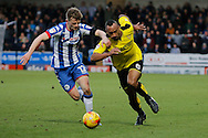 Wigan Athletic defender Callum Connolly(12) and Burton Albion striker Chris O'Grady (8) during the EFL Sky Bet Championship match between Burton Albion and Wigan Athletic at the Pirelli Stadium, Burton upon Trent, England on 14 January 2017. Photo by Richard Holmes.