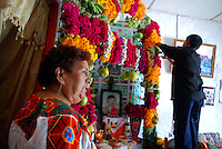 """MEXICO, Veracruz, Tantoyuca, Oct 27- Nov 4, 2009. An elaborate family altar in Chicontepec. """"Xantolo,"""" the Nahuatl word for """"Santos,"""" or holy, marks a week-long period during which the whole Huasteca region of northern Veracruz state prepares for """"Dia de los Muertos,"""" the Day of the Dead. For children on the nights of October 31st and adults on November 1st, there is costumed dancing in the streets, and a carnival atmosphere, while Mexican families also honor the yearly return of the souls of their relatives at home and in the graveyards, with flower-bedecked altars and the foods their loved ones preferred in life. Photographs for HOY by Jay Dunn."""