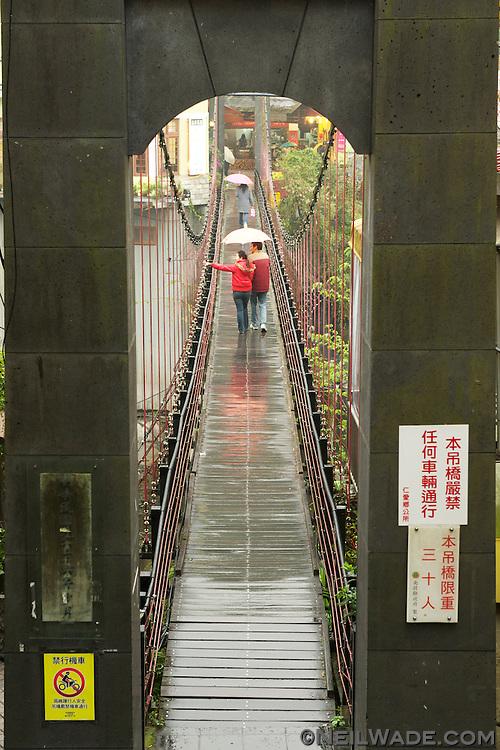 Like many aboriginal villages, Lushan has a suspension bridge.