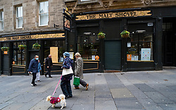 Edinburgh, Scotland, UK. 14 November 2020. Views of Edinburgh city centre on Saturday afternoon during a level 3 lockdown imposed by the Scottish Government;.Pictured;  The Malt Shovel pub is closed. Iain Masterton/Alamy Live News.