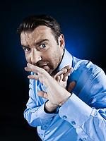 caucasian man hide afraid unshaven portrait isolated studio on black background