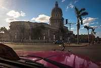 HAVANA, CUBA - CIRCA MAY 2016: Typical old classic car driving through the Capitol in Havana