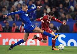 Liverpool's Andrew Robertson (right) and Leicester City's Islam Slimani battle for the ball battle for the ball during the Carabao Cup, third round match at the King Power Stadium, Leicester.