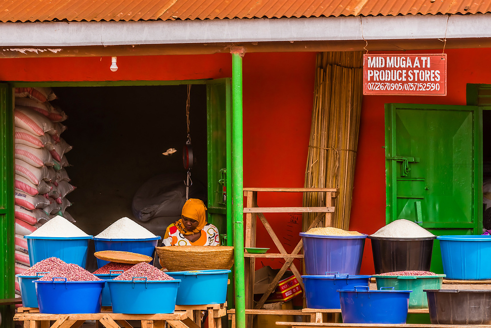 A produce shop has an advertisement painted on its exterior, Hoima, Uganda.