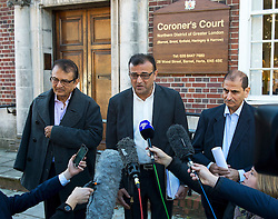 © Licensed to London News Pictures. 09/10/2015. London, UK. Anni Dewani's father Vinod Hindocha (left) and uncle Ashock Hindocha (centre) giving a statement to media outside North London Coroner's Court in Barnet, north London where a Coroner ruled there will be no inquest into murdered honeymoon bride Anni Dewani. Photo credit: Ben Cawthra/LNP