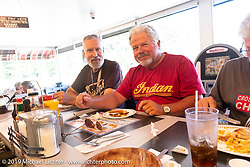 Paul Warrenfelt (L) and Walt Lumpkin (R) having lunch in a Waffle House during the Cross Country Chase motorcycle endurance run from Sault Sainte Marie, MI to Key West, FL. (for vintage bikes from 1930-1948). Stage-6 from Chattanooga, TN to Macon, GA USA covered 258 miles. Wednesday, September 11, 2019. Photography ©2019 Michael Lichter.