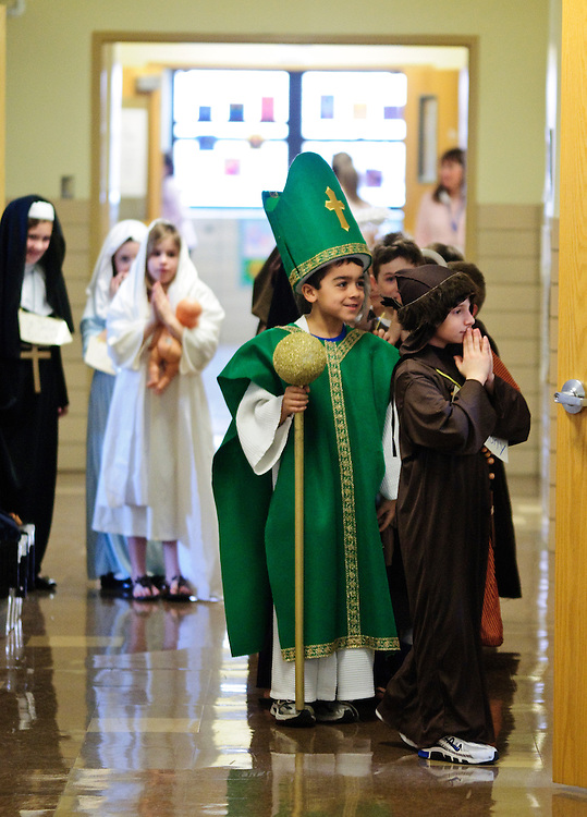 """Second grade students at St. Michael School in Orland Park portray their favorite religious figures during the school's annual Parade of Saints, February 2. During the event, costumed students stand motionless in the school commons for parents, grandparents and friends to """"activate"""" the Saint, who will offer a brief historical description. The session is followed by a parade through the school. l Brian J. Morowczynski~ViaPhotos..For use in a single edition of Catholic New World Publications, Archdiocese of Chicago. Further use and/or distribution may be negotiated separately. ..Contact ViaPhotos at 708-602-0449 or email brian@viaphotos.com."""