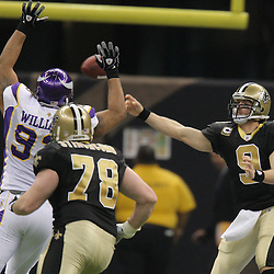 Jan 24, 2010; New Orleans, LA, USA; New Orleans Saints quarterback Drew Brees (9) is pressured by Minnesota Vikings defensive tackle Kevin Williams (93) during a 31-28 overtime victory by the New Orleans Saints over the Minnesota Vikings in the 2010 NFC Championship game at the Louisiana Superdome. Mandatory Credit: Derick E. Hingle-US PRESSWIRE
