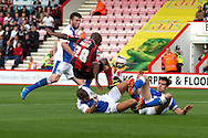 Tonkelo Rantie of AFC Bournemouth © collides with Scott Dann and Tommy Spurr of Blackburn Rovers during the Skybet Championship match, AFC Bournemouth v Blackburn Rovers at The Goldsands Stadium in Bournemouth, England on Saturday 28th September 2013. Picture by Sophie Elbourn/Andrew Orchard Sports Photography.