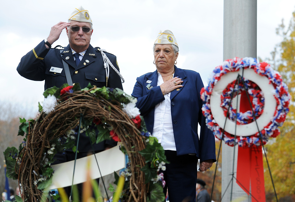 Disabled American Veterans Department of Massachusetts Commander Kenneth J. Kooyman and Auxiliary Commander Gloria Follis salute to their wreath during the Veterans Day ceremony at Massachusetts National Cemetery.
