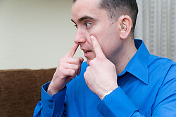 Man with a hearing impairment talking using sign language,