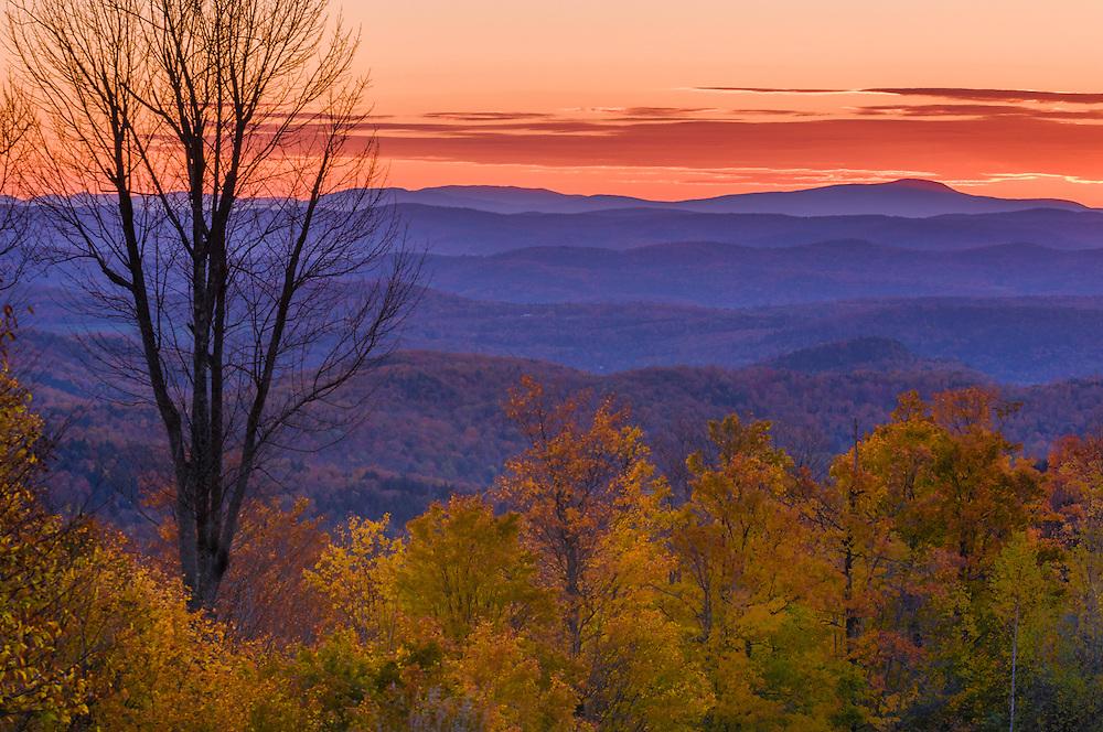 Dawn colors in sky, mountain ridge lines in fall, Bethel, VT