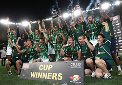 South Africa celebrate after beating New Zealand to win the Cup Final during the Cup Final match between South Africa and New Zealand on Day 2 of the HSBC Sevens World Series Port Elizabeth Leg held at the Nelson Mandela Bay Stadium on 8th December 2013 in Port Elizabeth, South Africa. Photo by Shaun Roy/Sportzpics