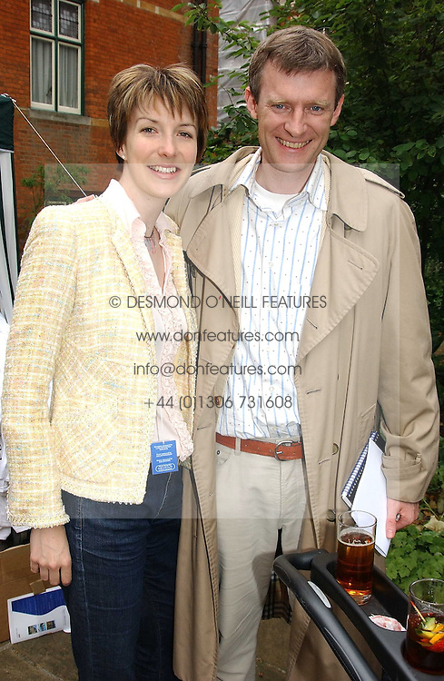 JEREMY VINE and his wife RACHEL at the annual House of Lords v House of Commons tug of war match in aid of  of  Macmillan Cancer Relief on 22nd June 2004.  A drinks reception was held in College Gardens followd by the tug of war on Victoria Tower Gardens, London.