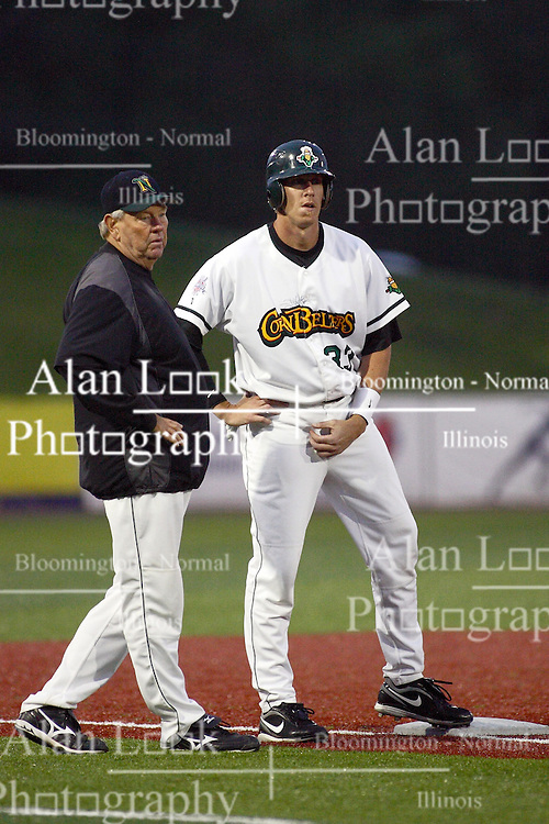 09 June 2011: Jeff Dunbar holds up at third and has a chat with Manager Hal Lanier during a game between the Lake Erie Crushers and the Normal Cornbelters at the Corn Crib in Normal Illinois.