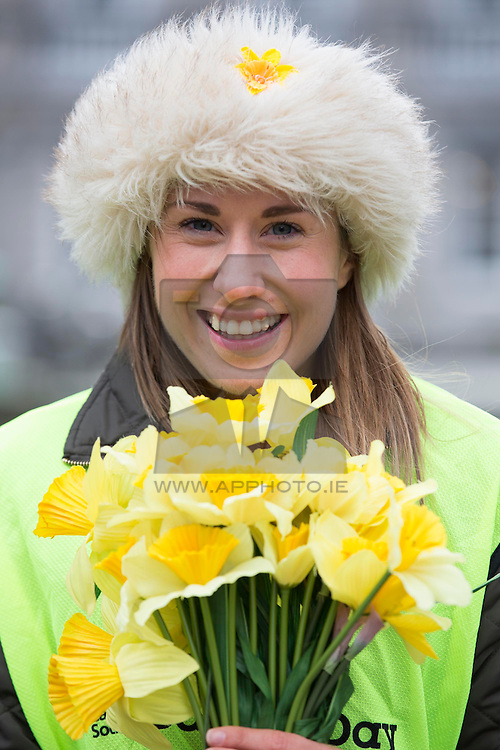 REPRO FREE: 28/03/2014 Daffodil Day Volunteer Ciana Casey is pictured selling Daffodils in Dublin for the Irish Cancer Society's Daffodil Day. The Irish Cancer Society Daffodil Day volunteers were trying to raise €3.45 m for the Society's free nationwide cancer services and research.<br /> It is not too late to support Daffodil Day, you can make a secure online donation by visiting www.cancer.ie Picture Andres Poveda