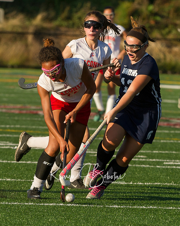 Laconia's Destiny Jones gets a shot off ahead of White Mountain's 13/Glidden during NHIAA Division Field Hockey on Wednesday.  (Karen Bobotas/for the Laconia Daily Sun)