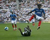 Photo: Steve Bond. <br />Derby County v Portsmouth. Barclays Premiership. 11/08/2007. Benjani Mwaruwari (R) vaults a tackle from Darren Moore (ground)