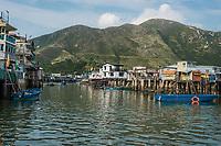 Tai O, Hong Kong, China- June 10, 2014: stilt houses and fishermen motorboats in Lantau island