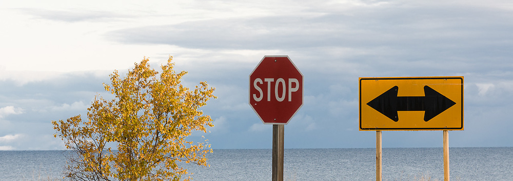 Lake Superior, directional and stop signs, morning light, October, Porcupine Mountains Wilderness State Park, Upper Peninsula, Michigan, USA