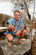 Photograph of Shelby Stanga, star of the History Channel's show Ax Men, posing with his 44 Magnum Ruger Blackhawk. New Orleans Photographer Frank Aymami.