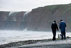 © Licensed to London News Pictures. 07/12/2012..Huntcliff, Saltburn by the Sea, Cleveland..As heavy overnight rain runs off the fields above the area known as Huntcliff near Saltburn in Cleveland the strong Northerly winds blow across the sea and up the face of the cliff blowing the water back over the cliff edge creating a dramatic waterfall effect...Photo credit : Ian Forsyth/LNP