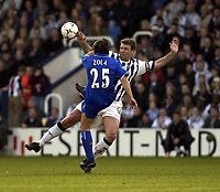 Copyright Sportsbeat. 0208 3926656<br />Picture: Henry Browne<br />Date: 12/01/2003<br />West Bromwich Albion v Chelsea FA Barclaycard Premiership<br />West Brom's Sean Gregan tries to stop a clearance from Chelsea's Gianfranco Zola