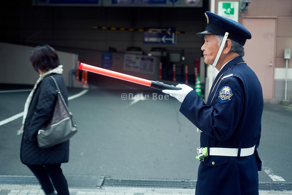 Japan elderly man working as parking attendant