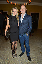 MARTIN LEWIS and his wife LARA LEWINGTON at a reception to celebrate the Debrett's 500 2015 - a recognition of Britain's 500 most influential people, held at The Club at The Cafe Royal, 68 Regent Street, London on 26th January 2015.