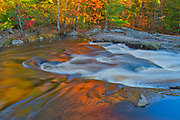 Maple Trees reflected in the Rosseau River at Lower Rosseau Falls in autumn<br />Rosseau<br />Ontario<br />Canada