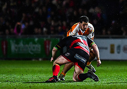 Cheetahs' Justin Basson is tackled by Dragons' Sam Hobbs<br /> <br /> Photographer Craig Thomas/Replay Images<br /> <br /> Guinness PRO14 Round 18 - Dragons v Cheetahs - Friday 23rd March 2018 - Rodney Parade - Newport<br /> <br /> World Copyright © Replay Images . All rights reserved. info@replayimages.co.uk - http://replayimages.co.uk