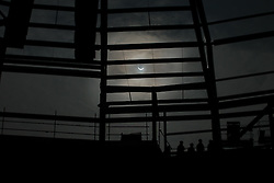 The Solar Eclipse is seen in the context of the new stand under construction at Bristol Sport's Ashton Gate Stadium, home to Bristol City FC and Bristol Rugby - Photo mandatory by-line: Rogan Thomson/JMP - 07966 386802 - 20/03/2015 - Bristol, England - Ashton Gate Stadium - 2015 Solar Eclipse in the UK.