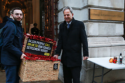 "London, UK. 3rd December, 2018. Campaigners from Amnesty International take a Christmas hamper of ""Israeli stolen goods"" including red wine, olive oil, honey, mineral water, eggs, dates, peppers, oranges and avocados to the Foreign Office to draw attention to the fact that these goods are all currently being produced in Israel's unlawful settlements in the occupied Palestinian West Bank and to call on governments around the world to ban the importation of Israeli settlement goods. All countries have a clear obligation to ensure respect for international humanitarian law and shouldn't recognise or assist the illegal situation that Israel's settlement policy has created."