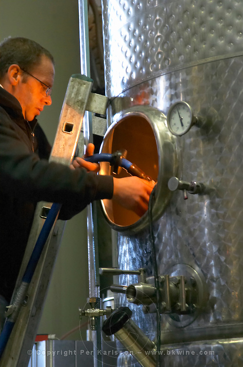Domaine Jean Louis Denois. Limoux. Languedoc. Cleaning the inside of a tank with pressurised water. France. Europe.