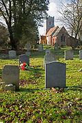 Graves in churchyard of village church, Bromeswell, Suffolk, England, UK