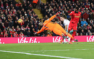 Divock Origi of Liverpool scores past Darren Randolph of West Ham United during the Premier League match at Anfield Stadium, Liverpool. Picture date: December 11th, 2016.Photo credit should read: Lynne Cameron/Sportimage