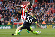 Shkodran Mustafi of Arsenal tackles Mame Diouf of Stoke city . Premier league match, Stoke City v Arsenal at the Bet365 Stadium in Stoke on Trent, Staffs on Saturday 13th May 2017.<br /> pic by Bradley Collyer, Andrew Orchard sports photography.